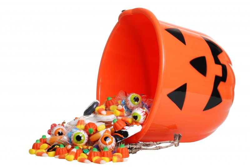 A bucket of candy spilling onto the floor.