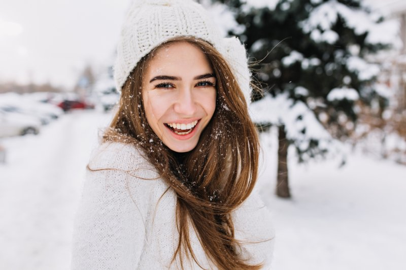 Woman smiling in the snow