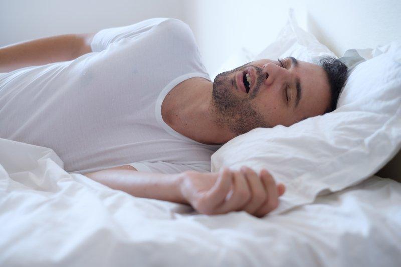Man sleeping while breathing through his mouth