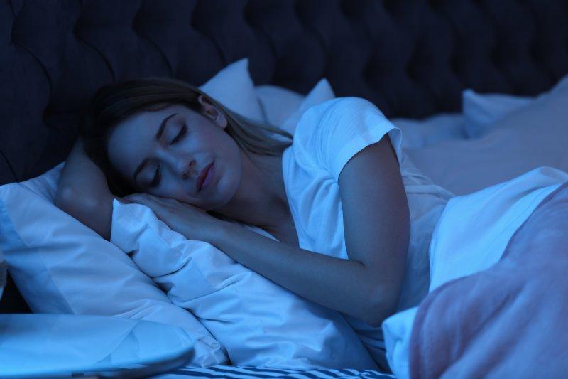 Woman sleeping peacefully at night